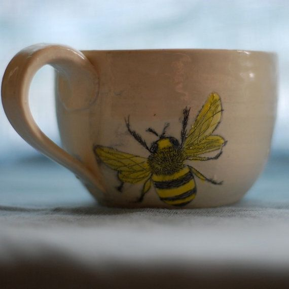 Hand thrown pottery + honeybees. Love the vintage look of this and the way it's totally modern. Hope the creator makes more!