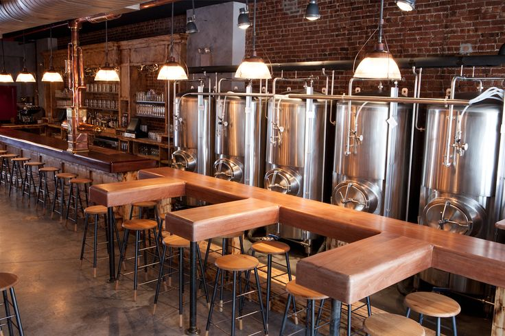 Polished Concrete floors at Paulaner complement the brick and wood.  Brewery Design | Floor | Polished Concrete | Concrete