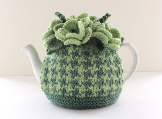 This is a beautiful hand-knitted tea cosy inspired by my love for pretty flowers, tea and the unmistakably stylish houndstooth. It is stunning , unique and of excellent quality. This is my own unique and original design so you wont find this elsewhere other than in my shop, (unless its a copycat!). I make all the cosies myself, using brand new wool of excellent quality and paying attention to detail. So you can be assured that your cosy is made with love poured into each and every stitch…