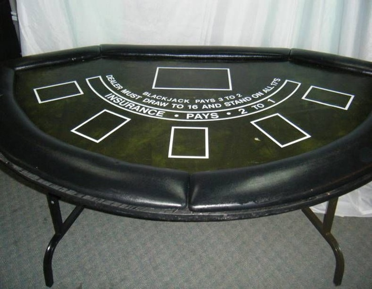 Blackjack Table. The Blackjack table with folding legs includes a card shoe.