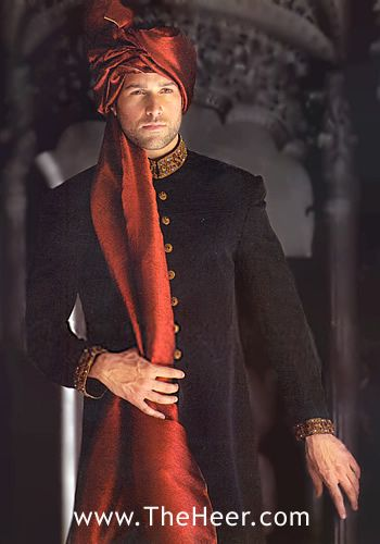 Rust color of turban for mehndi sherwani with cream colored kurta and pajama underneath