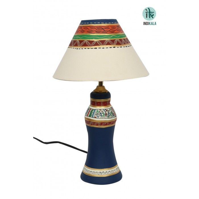 Terracotta Handpainted Tapered Blue Lamp This unique terracota tapered long lamp is beautifully handpainted. The shade has also been handpainted keeping in mind the color coordination with the earthen lamp. http://www.indikala.com/featured-products/terracotta-handpainted-tapered-blue-lamp.html
