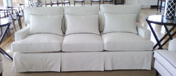 More white slipcovers for couches - at the beach and beyond.