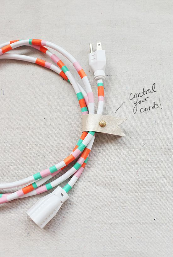 Such a clever DIY for prettying-up your power cords with washi tape.