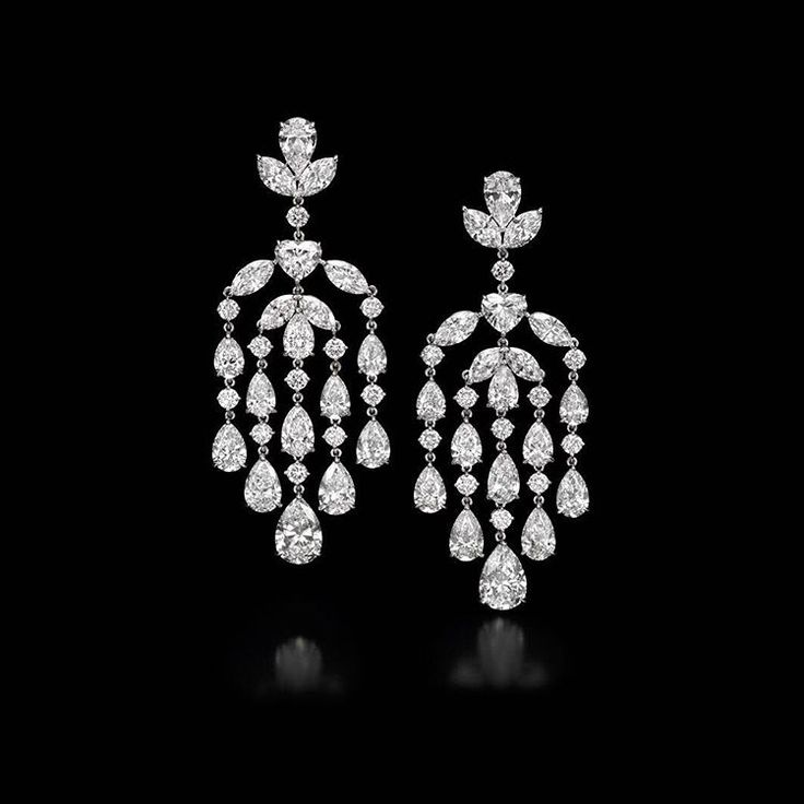 A pair of white diamond chandelier earrings.