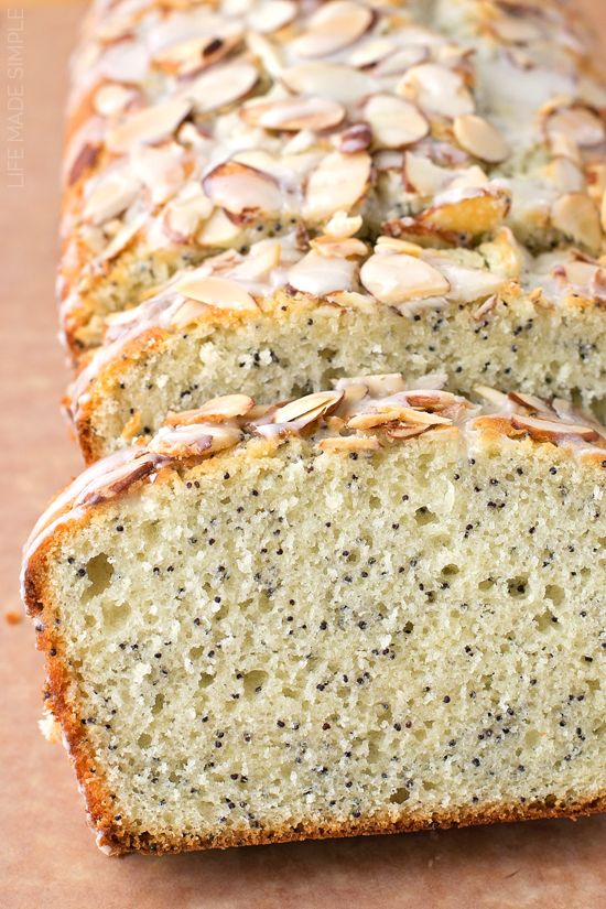 We love this moist and delicious almond poppy seed quick bread! It's got a crunchy topping with a sweet vanilla glaze.