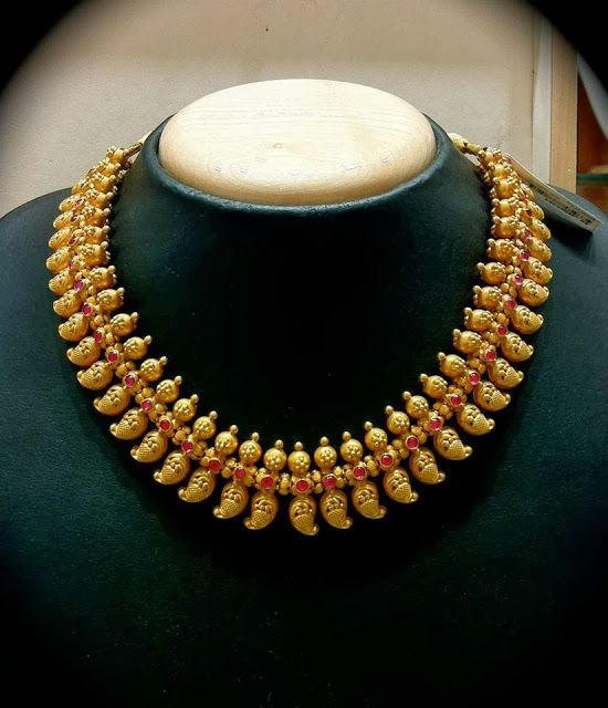 22 carat gold antique finish Southindia traditional mango necklace studded with rubies. Tamil