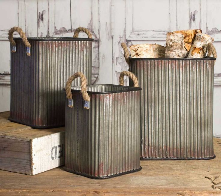 Set of Three Corrugated Storage Bins These corrugated storage bins feature ridged metal sides, a square shape, and heavy-duty rope handles tacked securely to the sides. They have a great industrial look. Small: 9