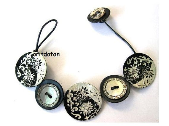 Bracelet button jewelry made of shell buttons with flowers ornament black and silver color with black leather cord