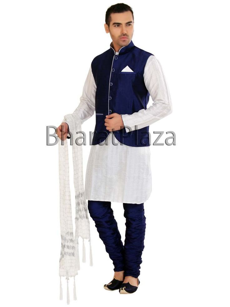 Fascinating Raw Silk Kurta With Jacket  Fascinating white color raw silk kurta with navy blue color jacket and breeches pant gives you a mind blowing and heart catching looks. Every man would want to drape this ensemble to get more dashing looks.