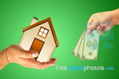 Hand With House And Money