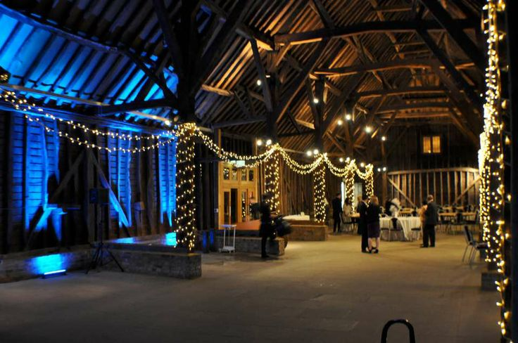 Dynamic, colour changing uplighting round the dancefloor area at the Great Barn Ruislip, with fairy lights too
