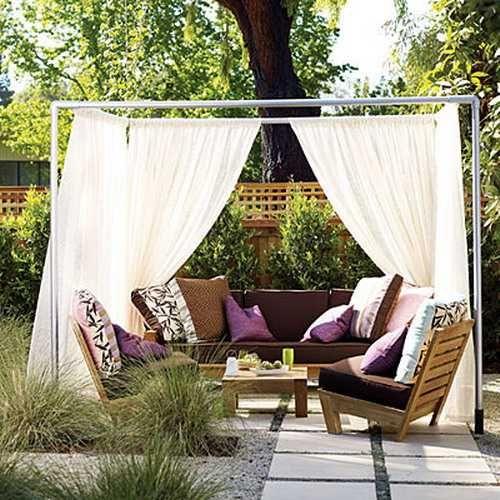 backyard patio design with light curtains