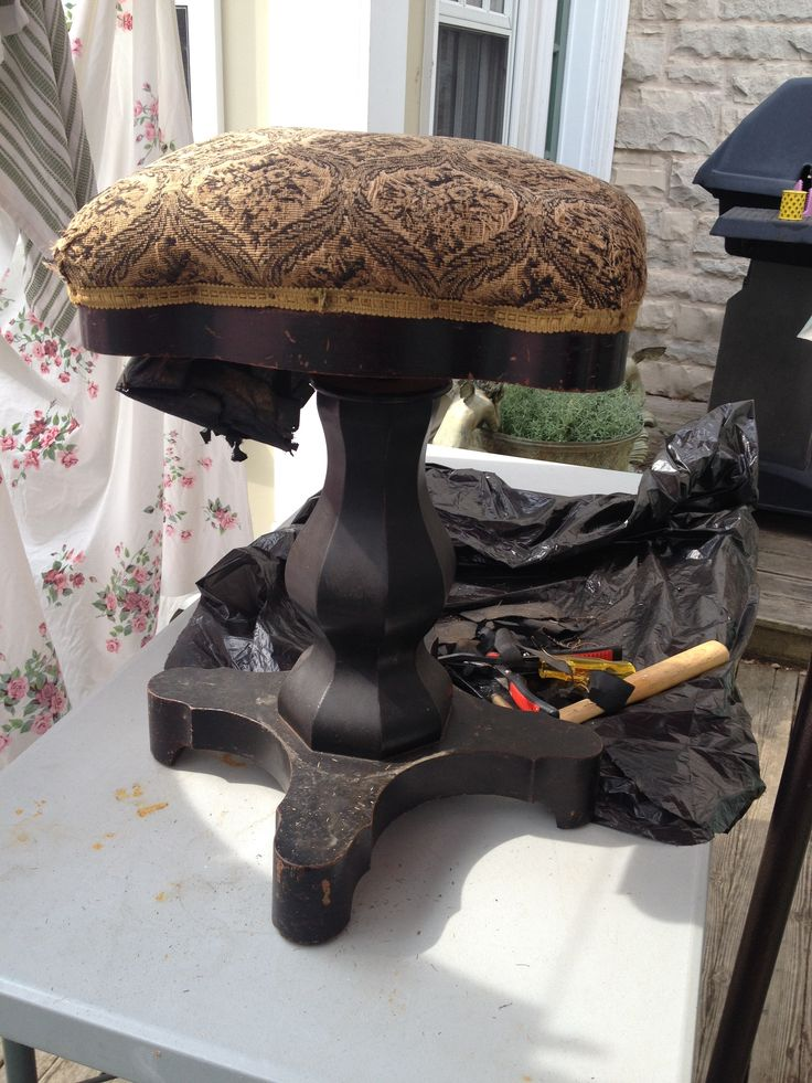 Great stool being stripped of old upholstery.
