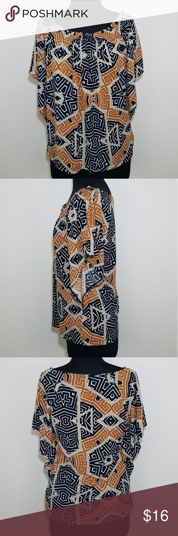 Geometric Short Sleeve Batwing Scoop Stretch Top Excellent used condition. No rips stains or tears.  Rust, beige, black and white geo print, short batwing sleeve, stretch blouse with elastic smocked scoop neck.  95% polyester, 5% spandex.   Size medium by East 5th. East 5th Tops Blouses