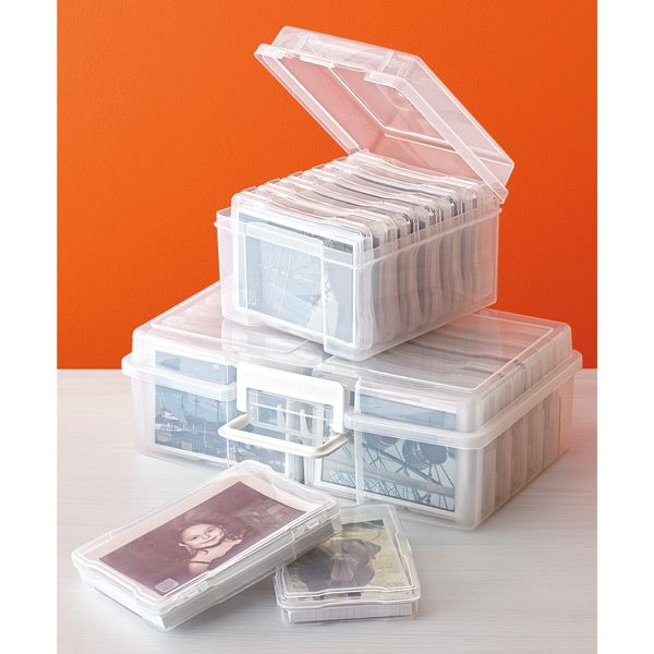 "{The Container Store} Organize your 4"" x 6"" photos or recipe cards with our 12-Case Photo Storage Carrier. It includes twelve inner cases that are easily transportable, fitting easily inside a purse or briefcase. Each acid-free inner case can accommodate approximately 100 photos and has a hinged lid that can be labeled by category or event for easy identification."