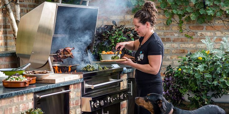 Chef Stephanie Izard cooking on a Kalamazoo Grill - The Kalamazoo is a seriously powerful gas grill that can also cook with charcoal and wood. Hand made by master craftsmen, its deep firebox design circulates heat more evenly for superior grilling, roasting and smoking... using any fuel you like.