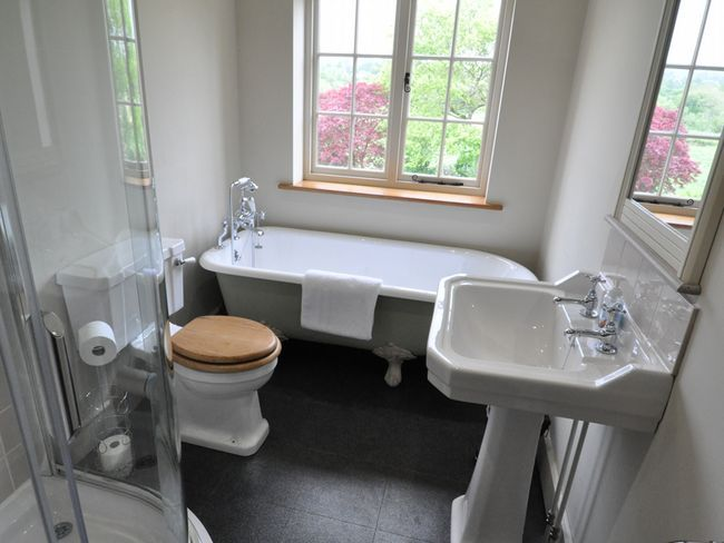 Perfect layout to incorporate a roll-top bath and separate shower in a classic tiny British bathroom