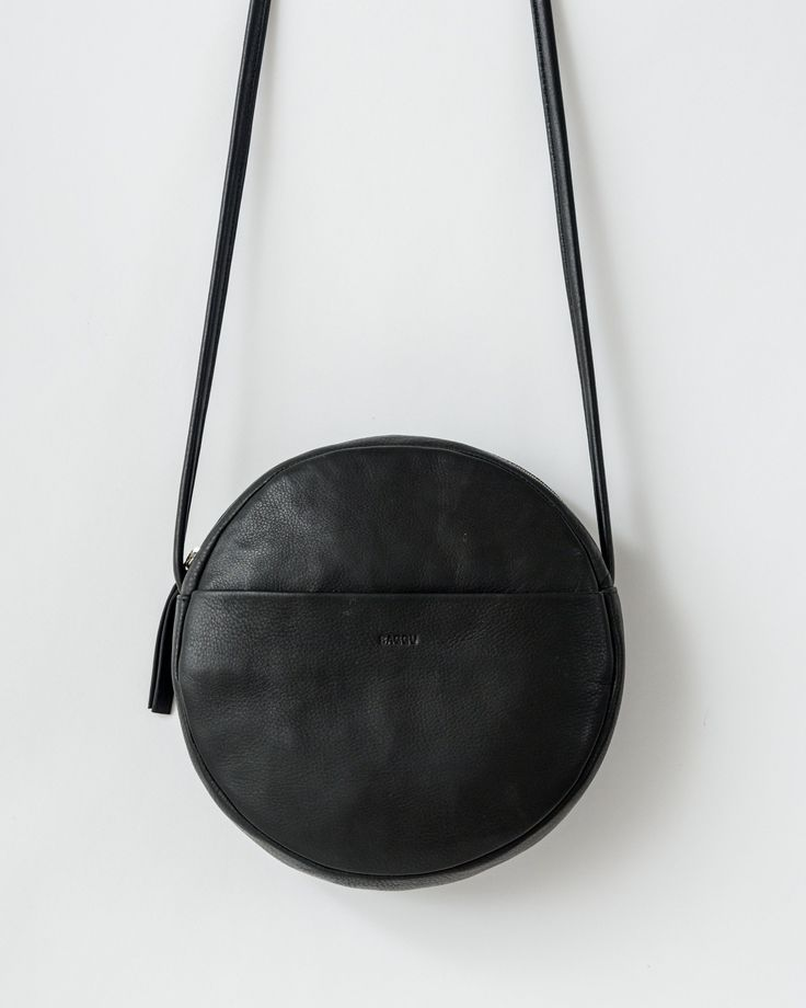 black round leather purse -- round purses are trending this fall
