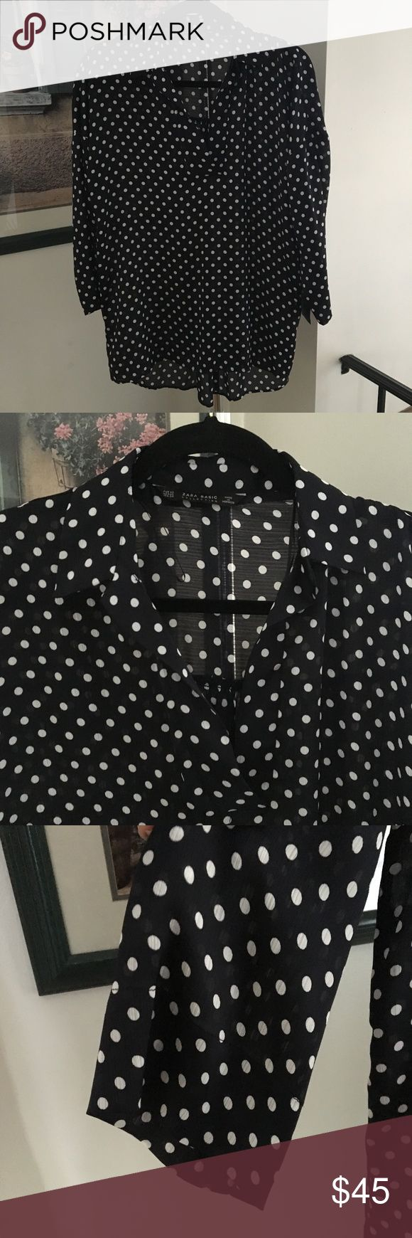 "Zara Spotted Smock Top Size XS Oversized blouse in sateen with a polka dot print, lapel collar and V-neck. Features long sleeves and asymmetric hem. Measurements: 31.5"" in length; armpit to armpit lying flat: 22"" Zara Tops Tunics"