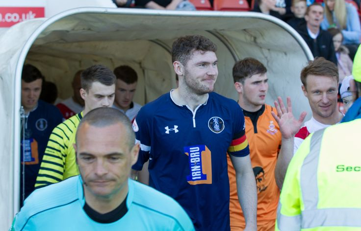 Queen's Park's Ryan McGeever leads his team out before the Ladbrokes League One game between Airdrieonians and Queen's Park