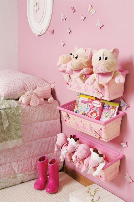 pink plastic baskets for storing toys and books