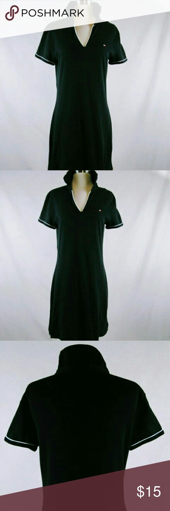 TOMMY HILFIGER BLACK POLO DRESS IN SHORT SLEEVES TOMMY HILFIGER BLACK POLO DRESS WITH A V NECK AND STAND UP COLLAR TRIMMED IN WHITE. V NECK ALSO TRIMMED IN WHITE AND COLLAR IS BLACK KNIT.  SUPER PREPPY SUPER CUTE WITH WHITE TENNIS SHOES. LOOSE FITTING WITH A CUT IN WAIST TO FLATTER YOUR FIGURE. NOT A MINI BUT FALLS ABOVE THE KNEE. 100% THICK COTTON. THIS IS NOT A POOR QUALITY COTTON.  NOT LINED BUT DOESNT NEED A LINING. BUST 36. WAIST 32/33 WEIGHT. 1.2 LBS. TOMMY HILFIGER Dresses