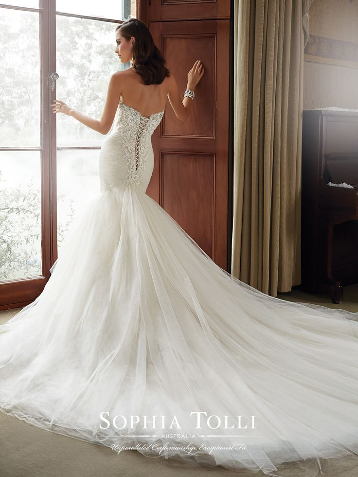 Sophia Tolli - Y21514 – Cory - Misty tulle fit and flare wedding dress, pleated tulle with lace and embroidered appliqués, tiered layers of tulle, full skirt with chapel train, strapless sweetheart neckline with dropped waistline and back corset. Removable spaghetti and halter straps included.  Sizes: 0 – 28  Colors: Almond, Ivory, White