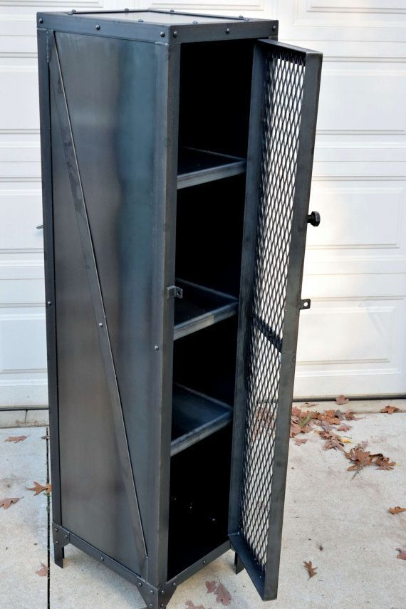 This Unique piece of industrial furniture is crafted from hot rolled steel, expanded metal and custom gussets. All of the Fabrication: Cutting, grinding, welding, drilling, riveting and construction is done by hand, one part at a time. This custom made industrial cabinet would work #industrialfurniture