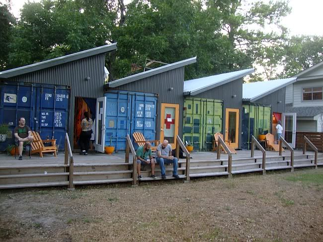 Well, it's sort of a community of shipping container cabins and I'll tell you why...  They really are container cabin/cottages but they're NOT homes, unf