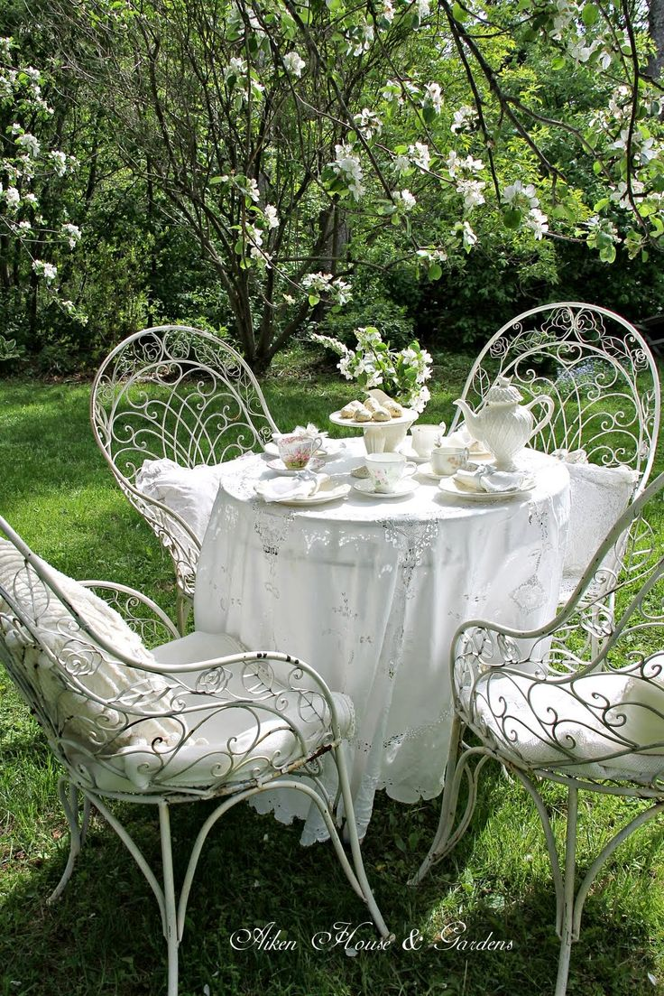 Alain loves having a Petite table et chaises for our garden.....
