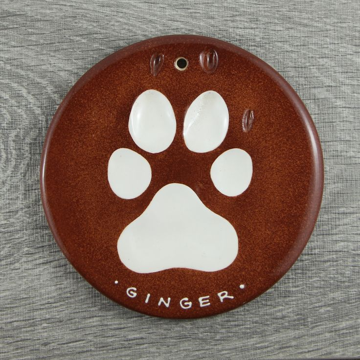 This impression of a dog named Ginger has a caramel coloured background. #dogpaw #paw #memories