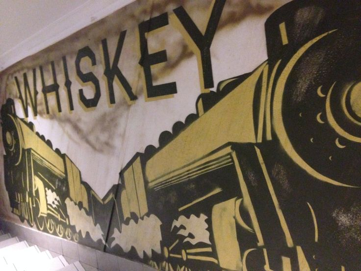 Whiskey in Haymaker typeface and train design in His Boy Elroy on Globe Lane, Wollongong