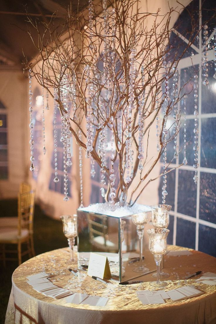beautiful centerpieces at this peach uplighting wedding reception diy