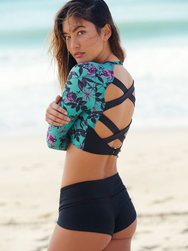 Isla Top | American made long sleeve swim top featuring allover floral print. Strappy back detailing with hook closure for an effortless fit. Contrast lining.