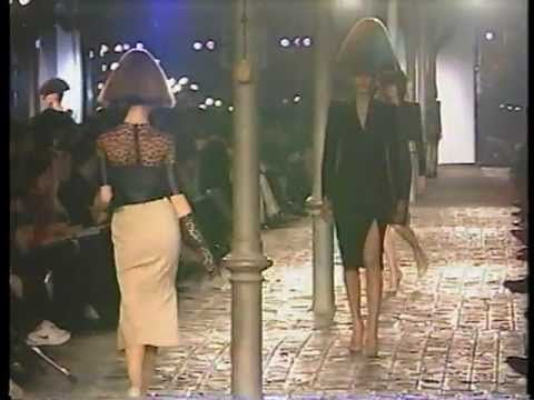 Alexander McQueen for Givenchy 1997. Leather garments, color being reduced to the minimum, extreme hairstyles. The model was cat-walking as if they were in their own world, getting high supported by the background music.