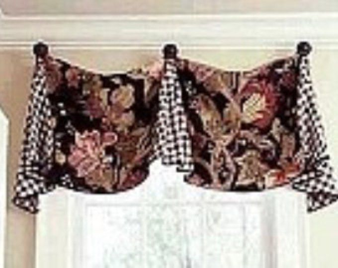 """This beautiful cuff top valance is lined with a coordinating fabric and interlined for stability. Can also be trimmed along bottom edge and/or top with your choice of trim and/or piping. This valance can either be installed on drapery hooks, medallions, drapery clips, or ties (add $15 for ties) Standard size fits a window 36-43 wide. The finished length of the valance is approximately 18"""" at the short point and 27"""" at the sides. Other sizes can be price quoted upon request. All seam..."""