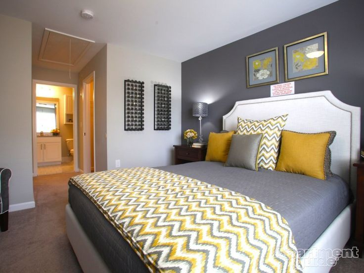 Grey and yellow makes for a classic colour combination for the bedroom. The white headboard keeps the room light with a pop of brightness.