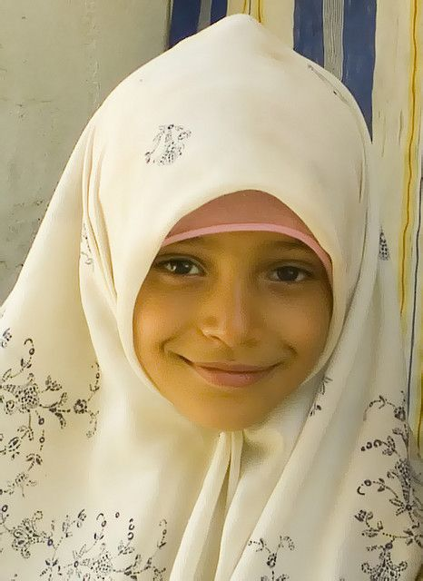 OMG, she is so very beautiful!  Just adorable and such a friendly face. Girl in Algiers, Algeria
