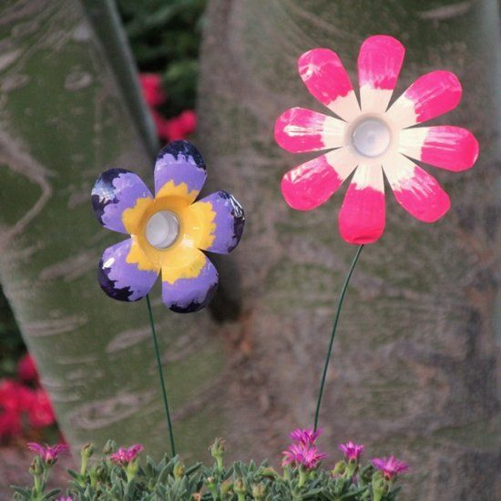 Transform plastic water bottles into flowery yard art with scissors, wire, paint and Mod Podge.