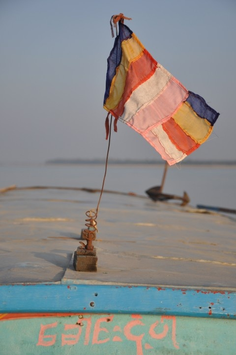 tiny hand sewn flag on  a burmese fisherman's boat.  love the color and patchwork.