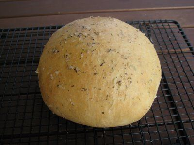 Rosemary Herb Bread:  Macaroni Grill  • 3 Tablespoons olive oil   • 2 1/2 cups flour   • 1 1/2 teaspoon salt   • 1 1/2 Tablespoons sugar   • ¼ teaspoon Italian seasoning  (or pinch of each ground garlic, dried oregano, and dried basil)• 1 1/2 Tablespoons rosemary   • 1 Tablespoon yeast   • additional rosemary to garnish