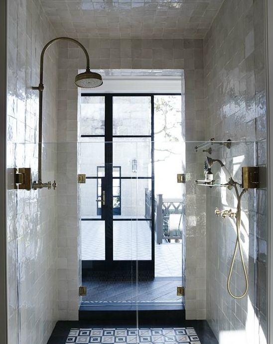 Shower. Natural light, floor, walls.