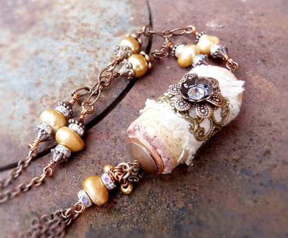Beguiling elegant long wine cork necklace. Wrapped up in watered champagne silk and topped with ornate filigree and antique copper finish flower