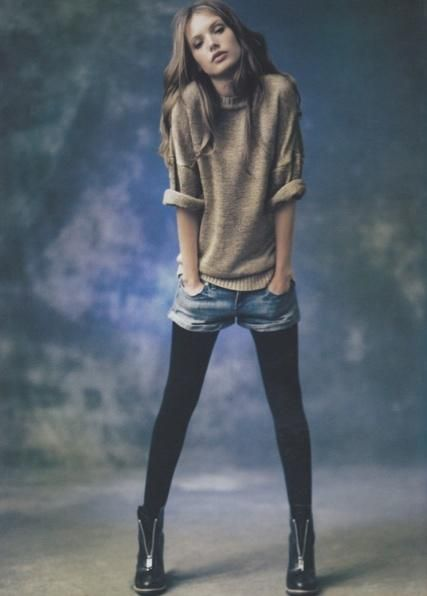 Shorts in the fall with a sweater, tights and edgy boots