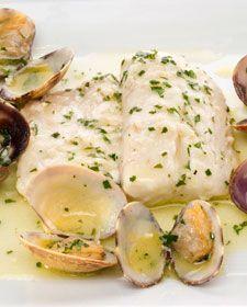Merluza en salsa verde con almejas. Hake and clams with salsa verde.