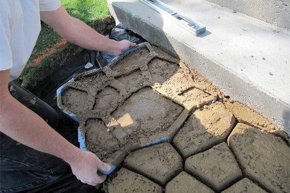 Creating a stamped concrete patio...exciting idea for the patio in the backyard.