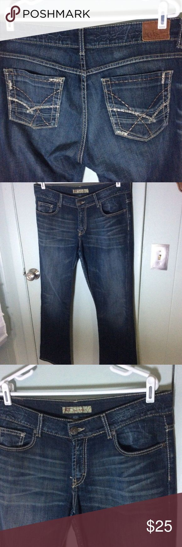 """Buckle BKE Denim Culture Mens Bootcut Jean BKE jeans style is culture....size marked on tag is 33 x 31.5..measures to 35 x 32...see actual measurements for correct fit...darker wash... a little metallic on the pockets....some wear at bottoms hems....see all pictures  17.5"""" waist  9.5"""" rise  32"""" inseam BKE Jeans Bootcut"""