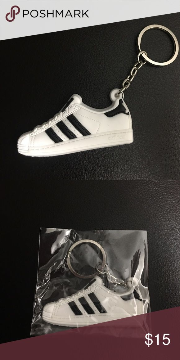 😎 Adidas Shell-Toe Keychain Mini silicone Adidas Superstar Shell-tops. Color: Classic White/ Black. Super cool looking. Check out my closet for other styles and fun new merchandise. Awesome stocking stuffer 🎄New in package! Adidas Accessories Key & Card Holders