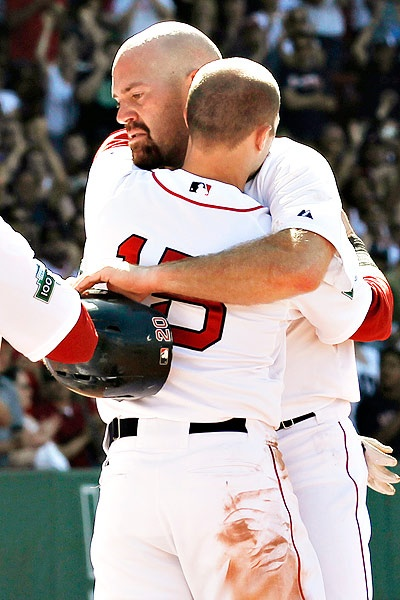 My BROmance - Kevin Youkalis receives a standing ovation from Fenway Faithful and a hug from Dustin Pedroia as he was pulled in the 7th inning today's Braves-Red Sox game with his trade to the White Sox imminent. Youkalis went 2-for-4 with an RBI triple in his final start for the Red Sox (6/24/2012).